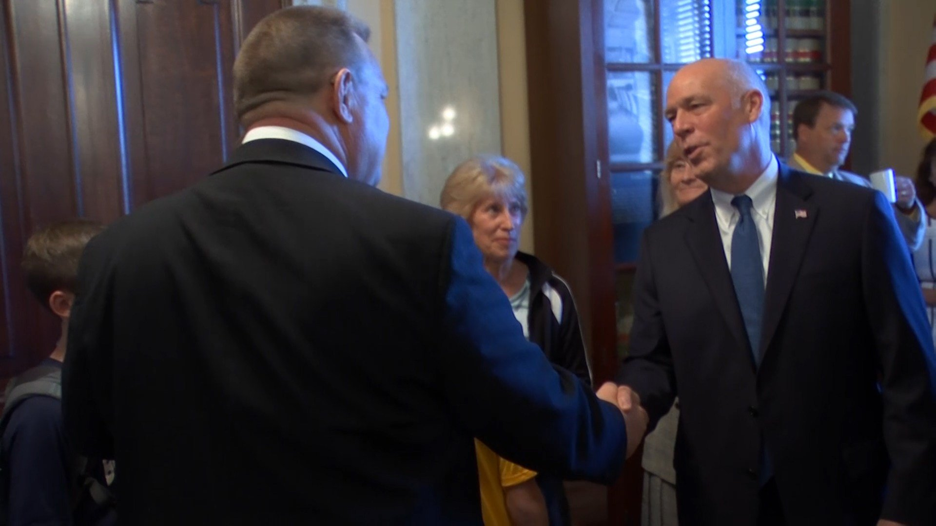 U.S. Rep. Greg Gianforte (right) shakes hands with U.S. Sen. Jon Tester