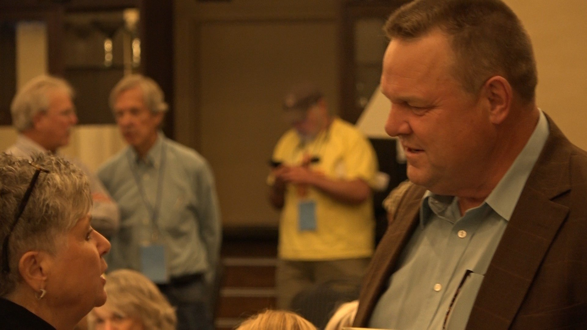 U.S. Sen. Jon Tester talks to MT Dem Party Executive Director Nancy Keenan