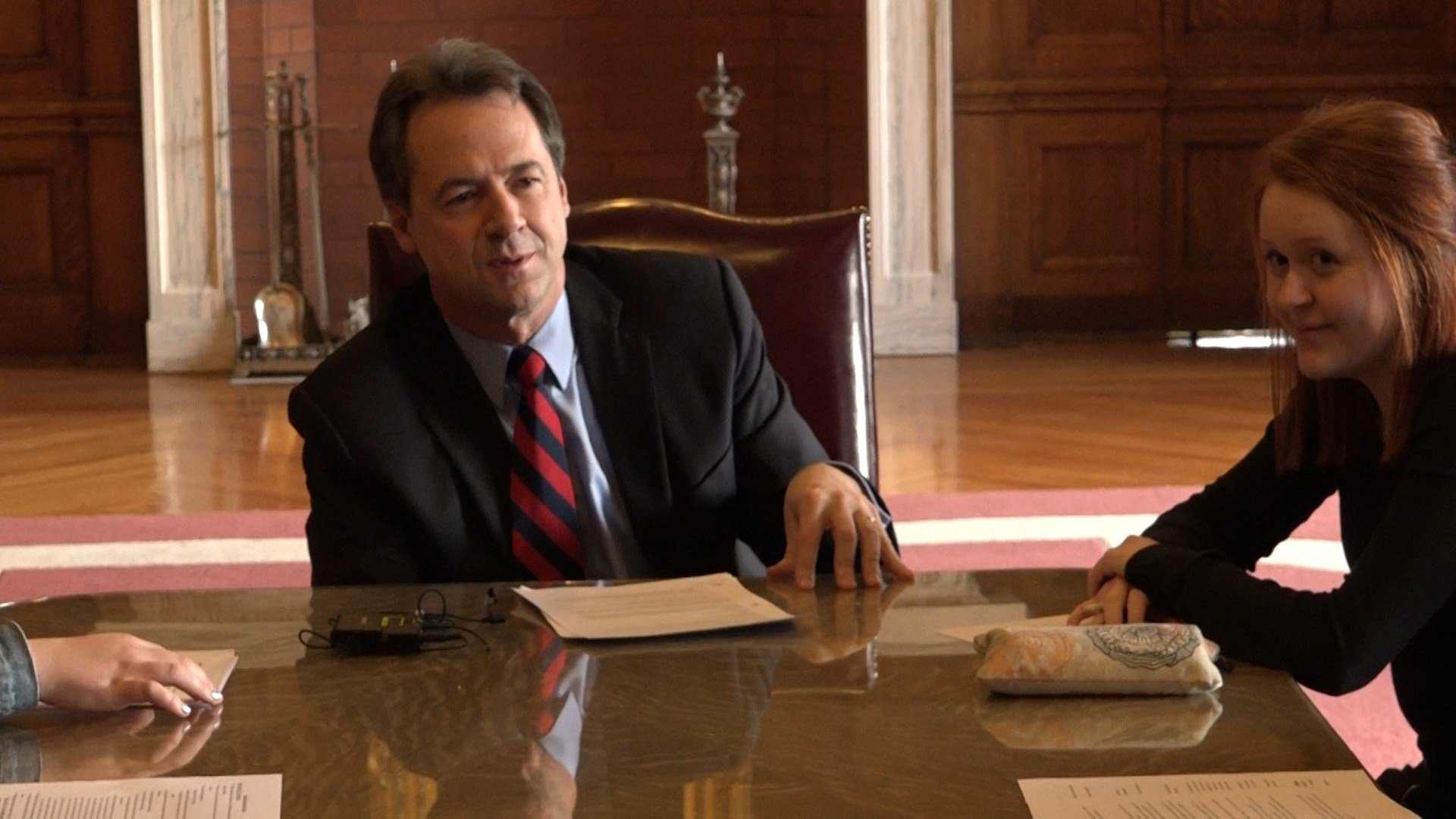 Gov. Steve Bullock talks with Mariah Thomas of Helena Youth Against Gun Violence